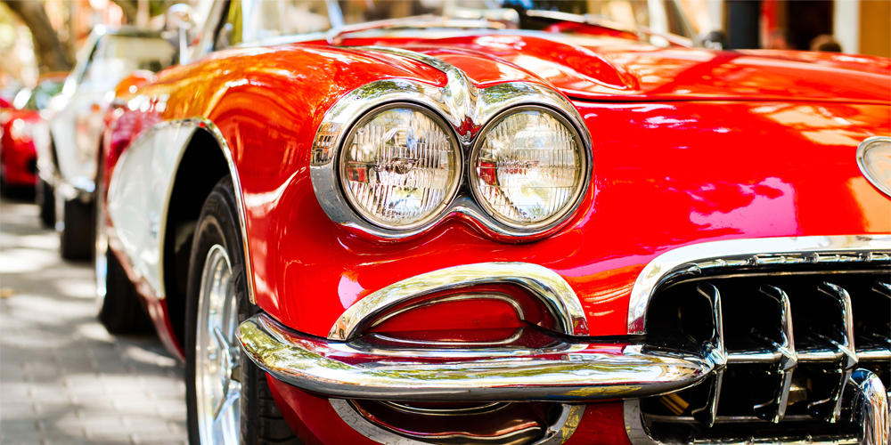 classic red vintage car in the daylight